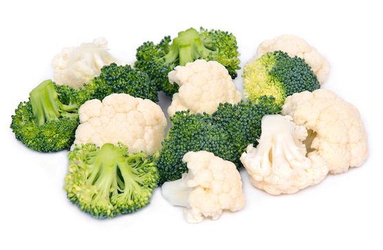 Fresh organic cauliflower and broccoli separated on white background